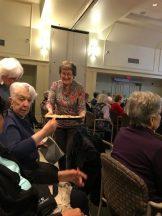 Denise Bunting serving cookies; Pat Duggan